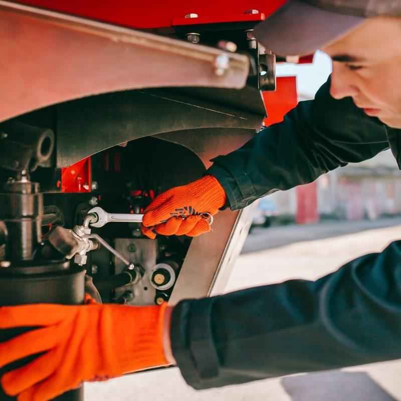 Rebuilders Enterprises - Closeup of Mechanic Working
